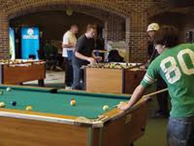 Students playing pool at the Kirkhof Center